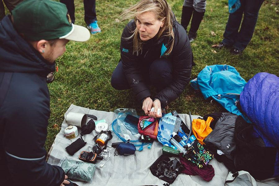 A new hiker askes an experienced hiker to look through her pack to determine if she is carrying unnecessary gear Photo by Meg Roussos courtesy ALDHA-West jpg